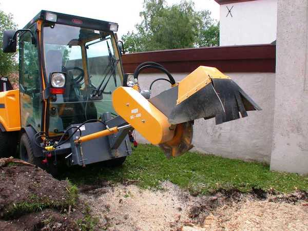 Stump grinding service using a bobcat grinder